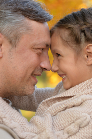 Portrait of father and daughter hugging in park