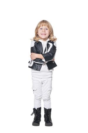 Portrait of cute boy posing on white background