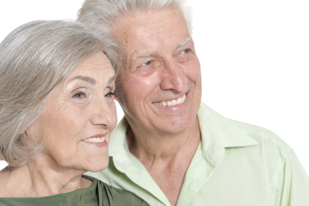 portrait of senior couple posing on white background