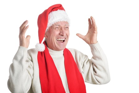 Senior man in Santa hat on white background Standard-Bild