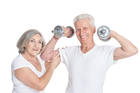 Portrait of active smiling senior couple doing exercise