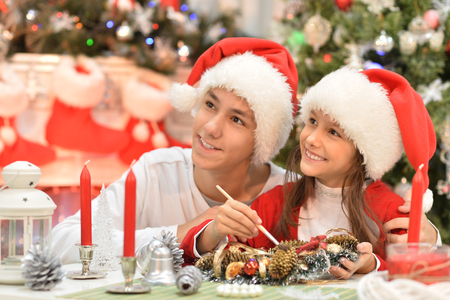 Portrait of brother and sister preparing for Christmas