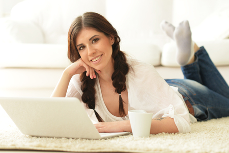 Portrait of beautiful brunette woman using laptop