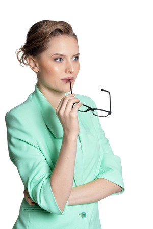 Portrait of young businesswoman with glasses on white background