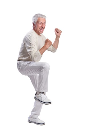 Full growth, senior man posing on white background