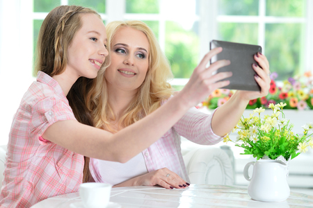 Portrait of mother and daughter using tablet Stock Photo