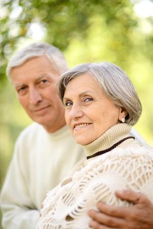 Portrait of cute happy senior couple sitting