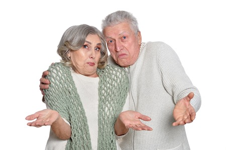 Portrait of happy senior couple posing on white background
