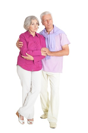 Portrait of a senior couple posing on white background