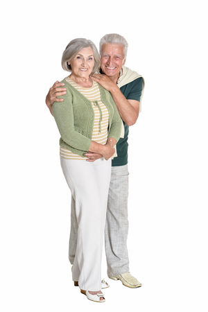 Portrait of a senior couple embracing isolated