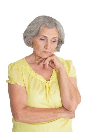 Sad senior woman  isolated on white background