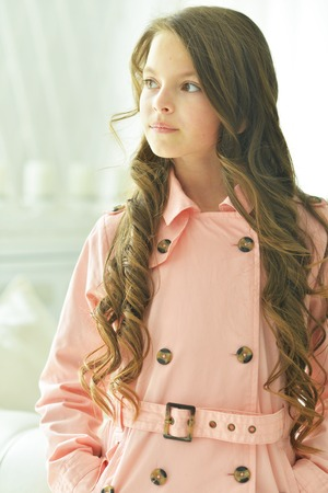 Cute little girl with long hair posing
