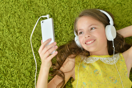 Portrait of cute little girl with headphones