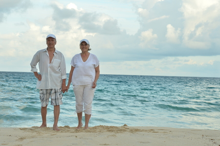 Portrait of elderly couple at tropical beach