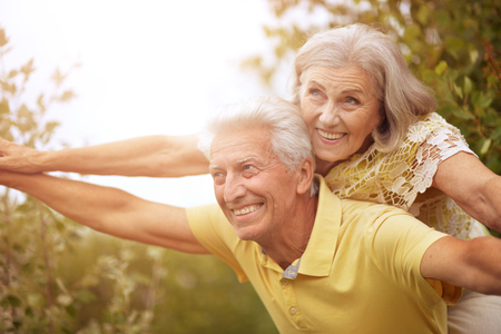 mature couple   in summer park Imagens