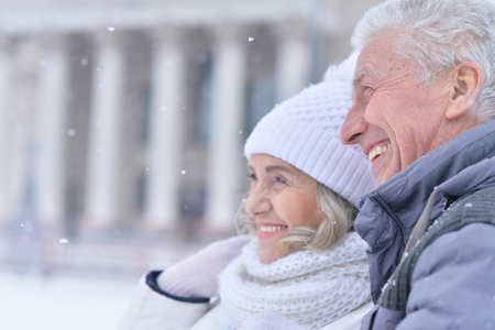 Happy senior couple posing at winter outdoors