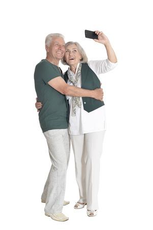 portrait of  senior couple taking selfie isolated Stock Photo