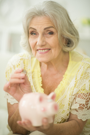 old woman with piggy bank