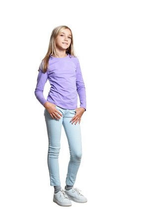 cute girl in casual clothing posing on white background Stock fotó