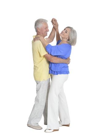 portrait of senior couple dancing on white background 免版税图像