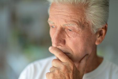 Close up portrait of Sad senior man