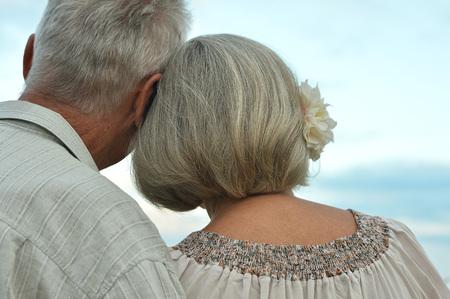senior couple on field of wheat