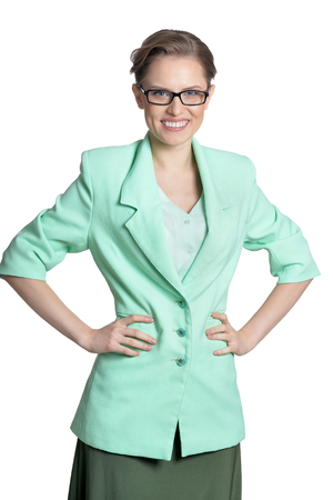 Portrait of young businesswoman in glasses on white background