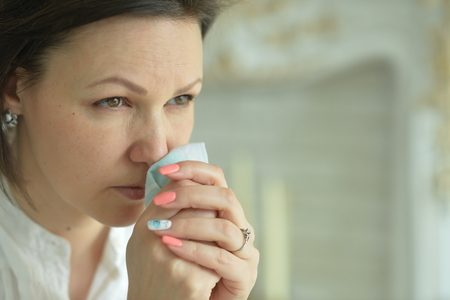 Sick Young woman crying Stock Photo