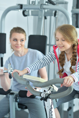 Portrait of young woman training with teenage daughter 스톡 콘텐츠