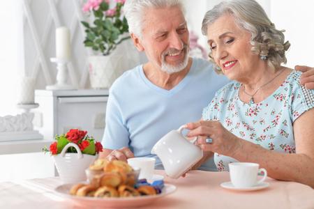 Portrait of happy Senior couple portrait drinking tea Stock Photo