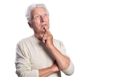 Thoughtful senior man posing on white background Imagens - 116495113