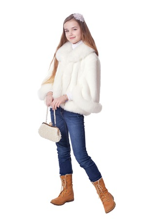 Happy little girl in fur coat   posing