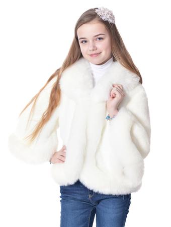 Happy little girl in white furry coat posing
