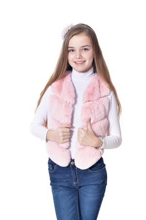 Happy little girl in pink fur vest posing 写真素材