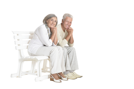 portrait of  senior couple sitting on bench