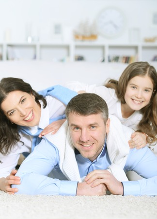 Happy parents and daughter posing