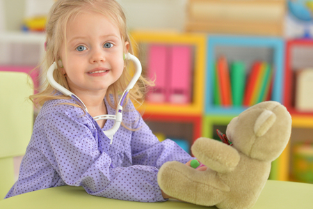 Cute little girl playing nurse