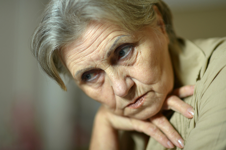 Close up portrait of tired senior woman