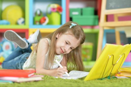 Cute schoolgirl at home