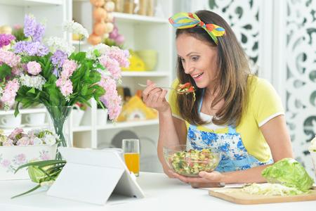 young woman preparing salad