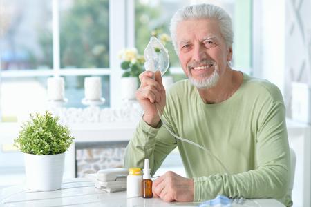 portrait of an elder man making inhalation