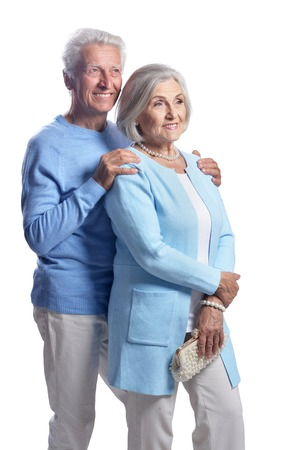 Portrait of happy senior couple on white background