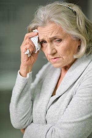 beautiful sad senior woman