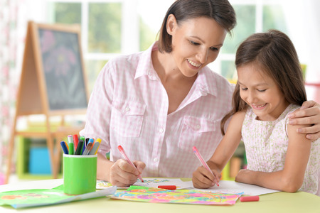 mother with little daughter drawing Stock Photo
