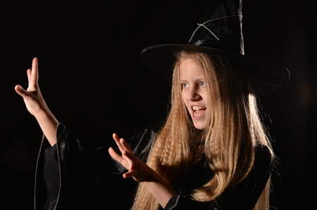 cute girl in witch costume Stock Photo