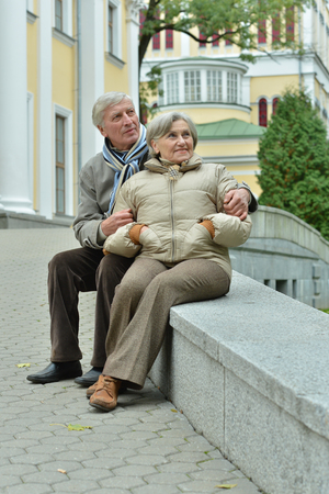 beautiful caucasian senior couple   in city sitting 스톡 콘텐츠