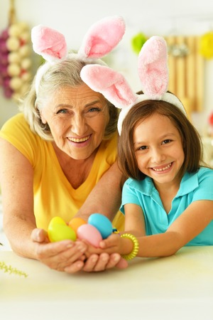 Senior grandmother and granddaughter with  Easter eggs 스톡 콘텐츠