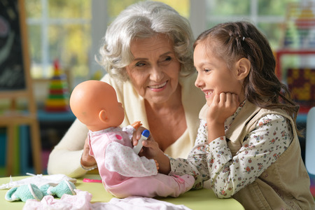 Grandmother and child play