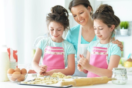 Mom and daughters cook