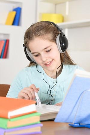 Cute schoolgirl in headphones